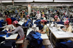 Employees work at the W & D Cambodia Co. Limited garment factory in Phnom Penh